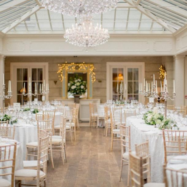 The Orangery at Tankardstown nestles comfortably around the main house at lower garden level. Bursting with light this wonderful airy space is adorned with chandeliers, antique furniture and gilt edged mirrors. Seating for up to 230 diners can be catered for at round tables. Photo by Christina Brosnan Photography.
